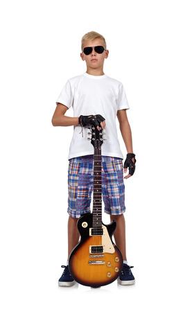 rocker: rocker boy with guitar on a white background Stock Photo