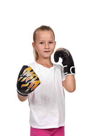 thai girl: little girl kid fighting with thai boxing gloves Stock Photo