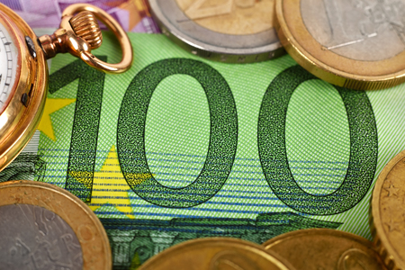 one hundred euro banknote: one hundred euro banknote and coins, close up Stock Photo
