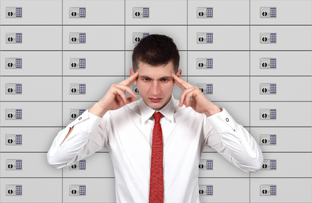 lockbox: businessman thinking and security safe room on background