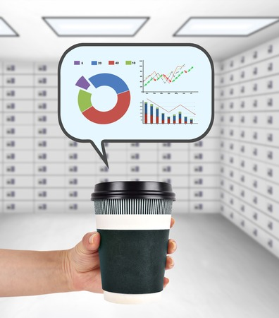 lockbox: hand holding disposable coffee cup with stock chart Stock Photo