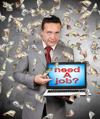 resourse: businessman points a finger at laptop monitor on which a need a job