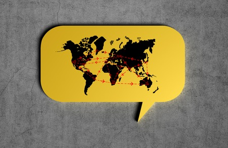 chat icons: yellow speech bubble with drawing  international flights scheme  on a concrete wall background Stock Photo