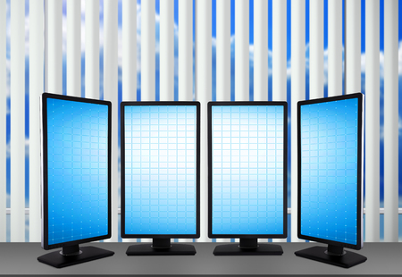 buy shares: four monitor with blank screen standing on table Stock Photo