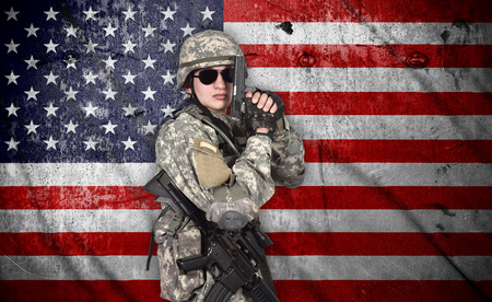 fatigues: soldier with rifle and gun on a american flag background