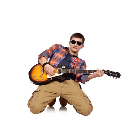 lead guitar: young man in shirt kneeling with a electric guitar