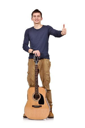 arms up: happy young man showing thumb up and holding acoustic guitar on a white background