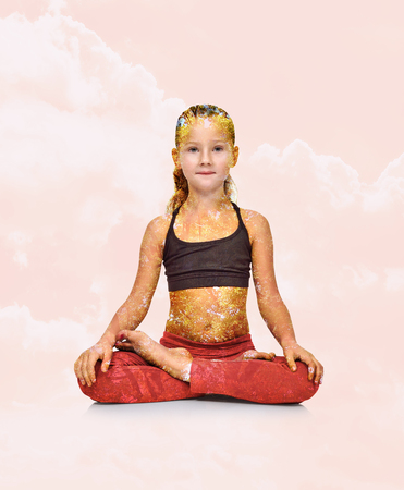 lotus effect: Little girl in red clothing sitting lotus position. Double exposure effect