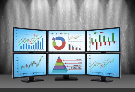 trading station which consists of four screens with financial data