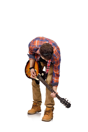 lead guitar: expressive rock musician is playing electrical guitar on white background