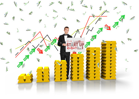 gold ingot: Businessman holding poster with start up concept. Graph of gold ingot on white background