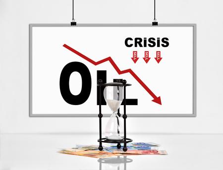 derrumbe: Cartel con estad�sticas colapso de los precios del petr�leo y el reloj de arena con los billetes en euros Foto de archivo