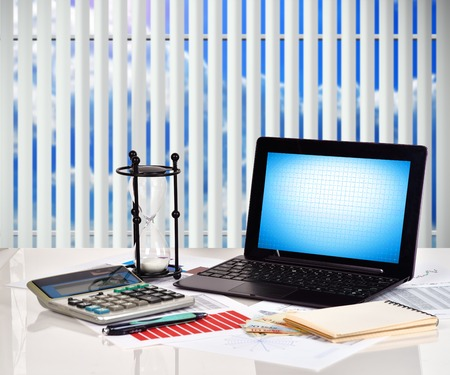 stock predictions: Notebook, financial and business charts and report on table Stock Photo