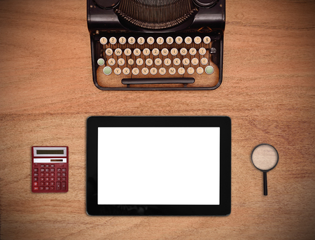 blank tablet: blank tablet, vintage typewriter, magnifier and calculator on wooden table