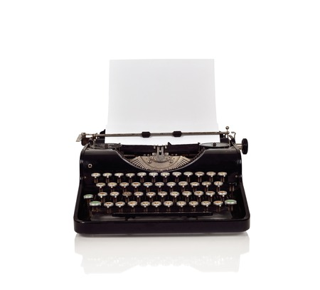 Vintage typewriter with paper on a white background