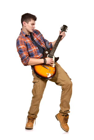 lead guitar: young man in shirt with guitar on white background