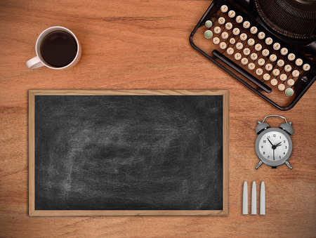 Blank chalk board on the table author. View from above