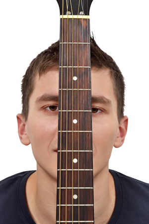 fretboard: Young guitarist and guitar fretboard on white background Stock Photo