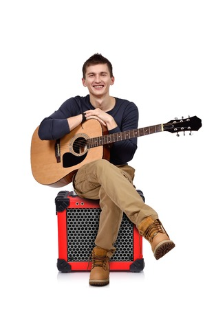 amp: young man with acoustic guitar sitting on combo amp