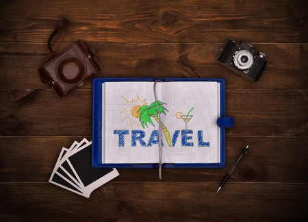 note pad: Camera, pen and note pad with drawing of travel concept.