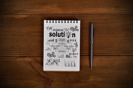 note pad: note pad with drawing business concept and pen on wooden table