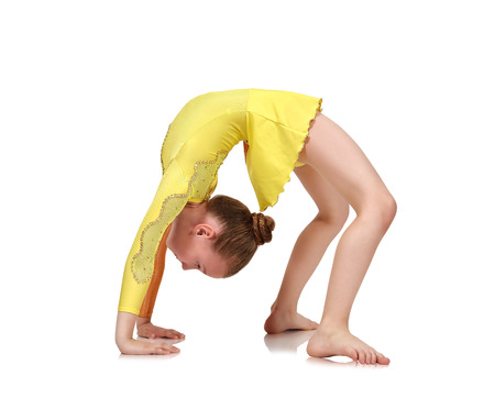whine: Little girl gymnast making bridge on a whine background Stock Photo