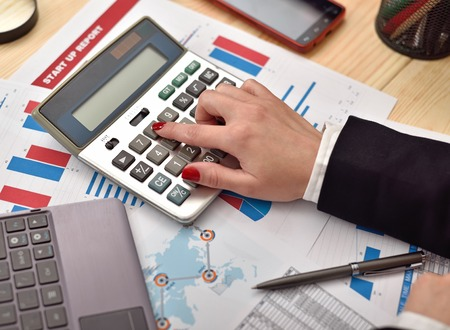 considers: accountant woman considers on the calculator profit