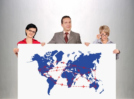 businesspeople holding poster with drawing scheme of international flights photo