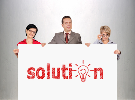 businesspeople holding poster with solution concept photo