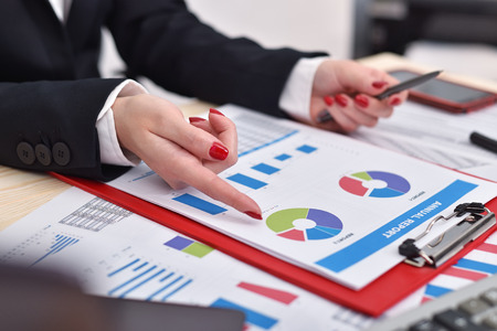 famale: businesswoman hand checks the start up report.  business concept