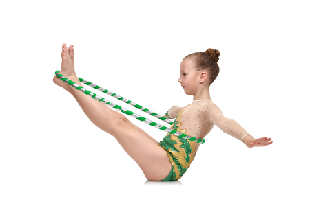 green clothes: artistic athlete performs in green clothes with ring Stock Photo