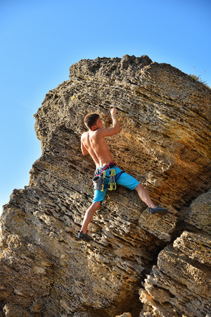 Extreme Climber With Equipment Climbs On A Rock