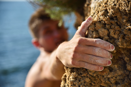 efforts: Climber making efforts to succeed. Gocus on the hand Stock Photo