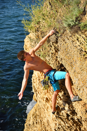 extreme climber man caught on a rockl, view from above Stock Photo