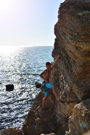 rockclimber: Extreme Climber With Equipment Climbs On A Rock