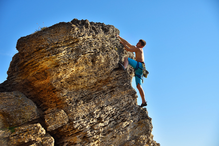 Male climber on mountains. Travel and tourism concept. Stock Photo