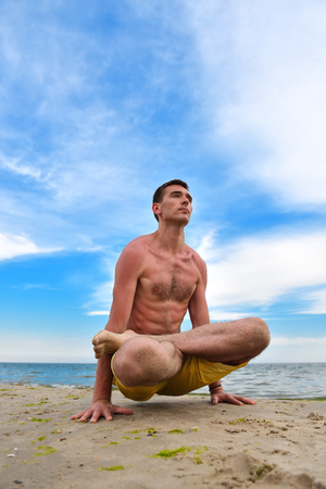 prana: Yoga man in meditation on beach, beautiful sea background