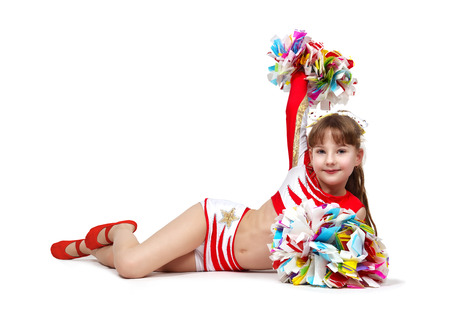 cheerleading squad: Young cheerleading girl with pompoms lying on the floor