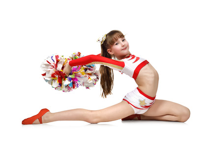 Young cheerleading girl with pompoms doing exercises