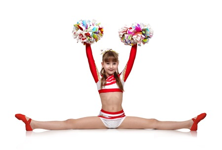cheerleading squad: cheerleading girl with pompoms sits on a splits