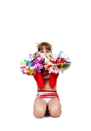 cheerleading squad: cheerleader girl sitting with pompons on a white background