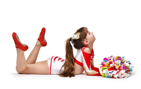 pom: Young cheerleader girl with pompoms doing exercises Stock Photo