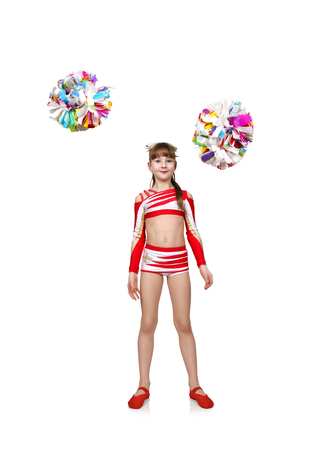 cheerleading squad: Young cheerleader girl in uniform throws pompons Stock Photo