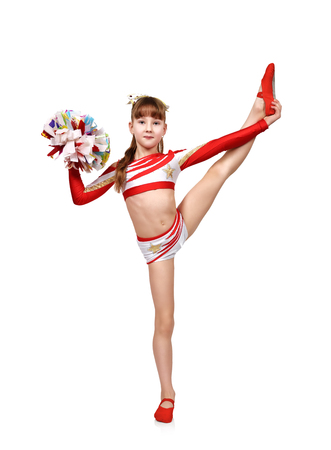cheerleader girl lifted her leg up on a white background Imagens