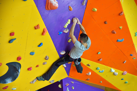unrecognizable: Free Climber Man Climbing On Practice Wall Indoors