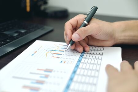 Stock Broker Analyzing At Stock Data And Checking Business Plan. Business Working Concept