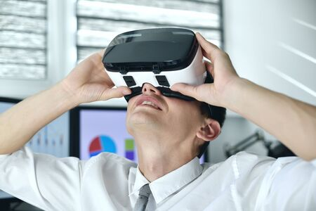 Stock Trader Man Wearing Virtual Reality Googles. Looking Around On Stock Chart And Report. Close Up