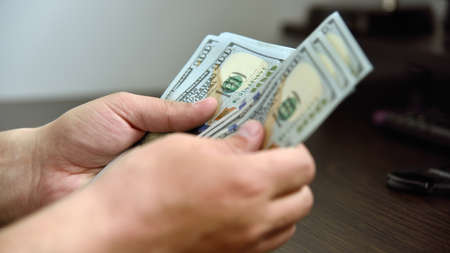 Close up of businessman hands counts money in hands. Financial success and wealth concept. Stok Fotoğraf
