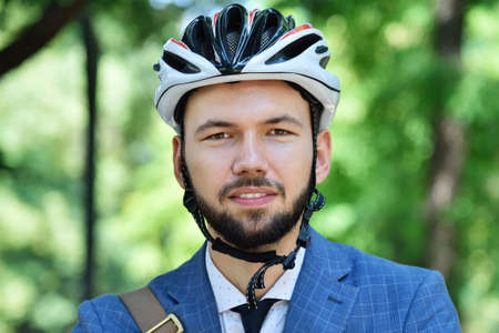 Young bearded businessman in helmet. Business and urban style concept. Close up Stok Fotoğraf