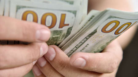 Businessman hands count money cash. Starting investment capital. Finance and trade concept. Close up